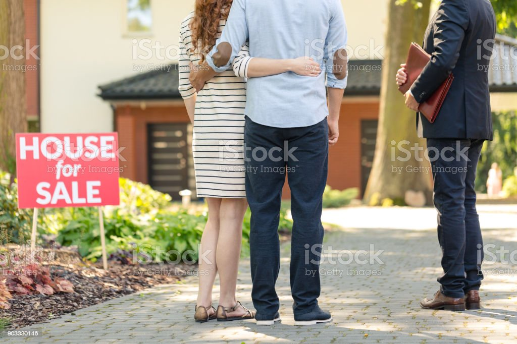 Back view of hugging couple stock photo