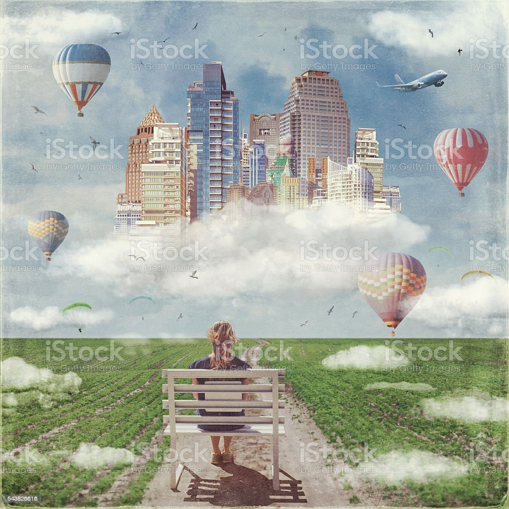 Back view of lonely  woman sitting on a bench stock photo