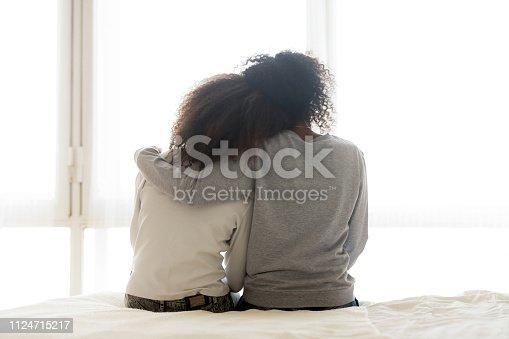 istock Back view of loving mom hug teen daughter 1124715217