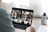 istock Back view of male employee have webcam conference with colleagues 1262376619