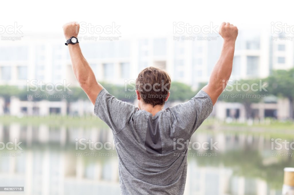 Back View of Man Celebrating Sport Success stock photo