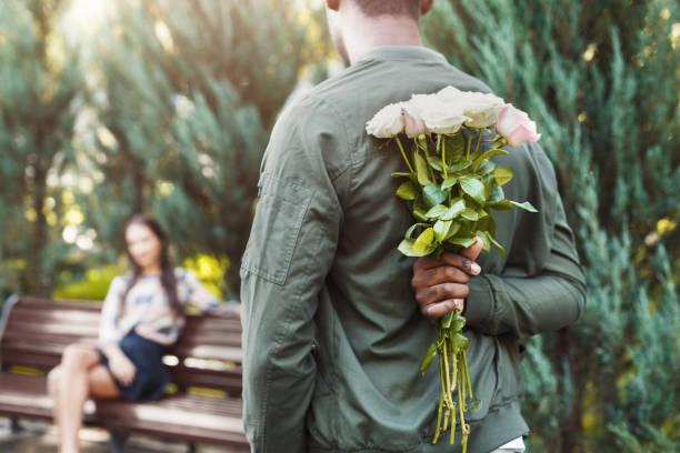 Back view of man holding flowers for girlfriend picture id939104054?b=1&k=6&m=939104054&s=612x612&w=0&h=pptbm1wzfyticmt5yhun8l5uy6ybvxewl3ts5f0s38o=