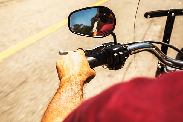 Back view of man on motorbike stock photo