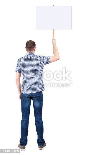 istock Back view  of man showing a sign board. 514518425