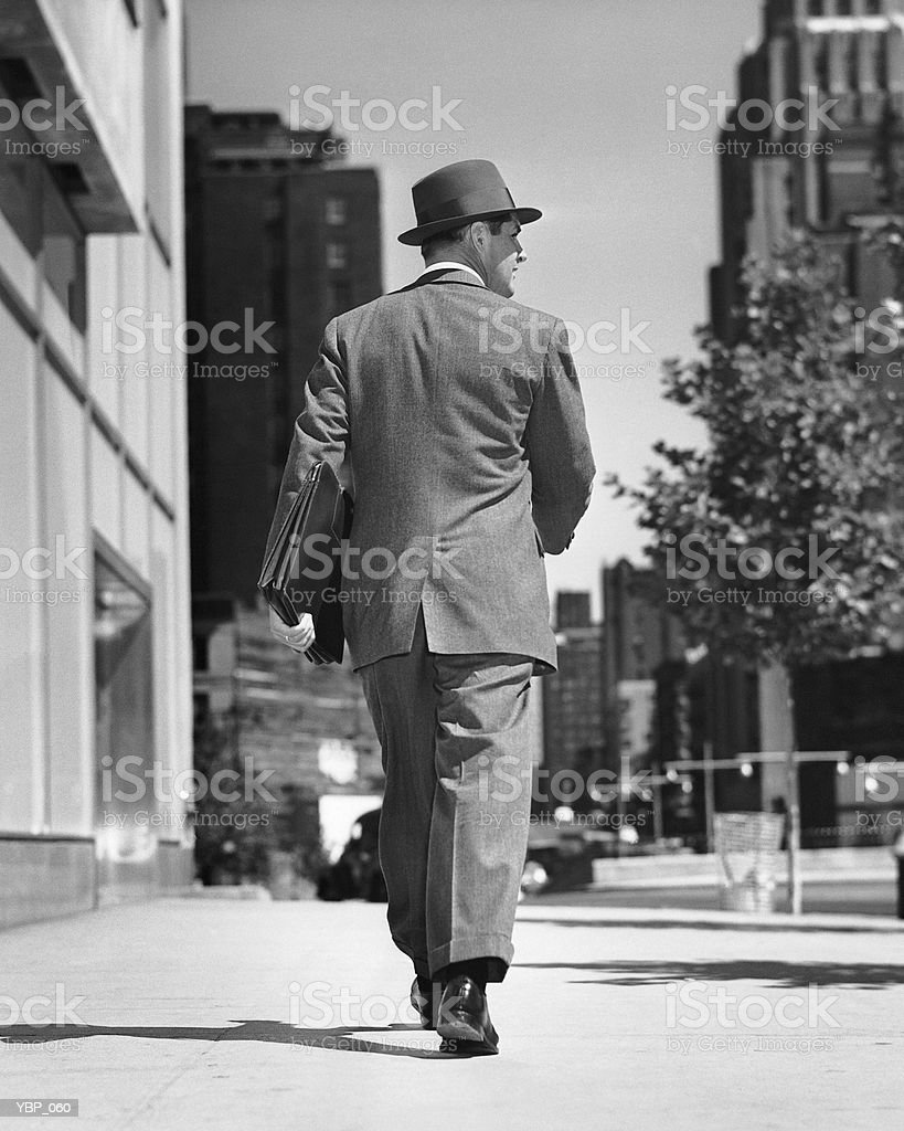 Back view of man walking on street royalty free stockfoto