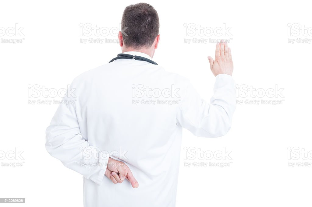 Back view of medic or doctor lying about Hippocratic oath stock photo