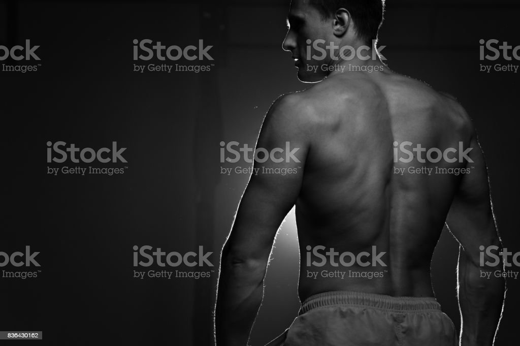 Back View Of Muscular Man With Weights In Hands Stock Photo & More ...