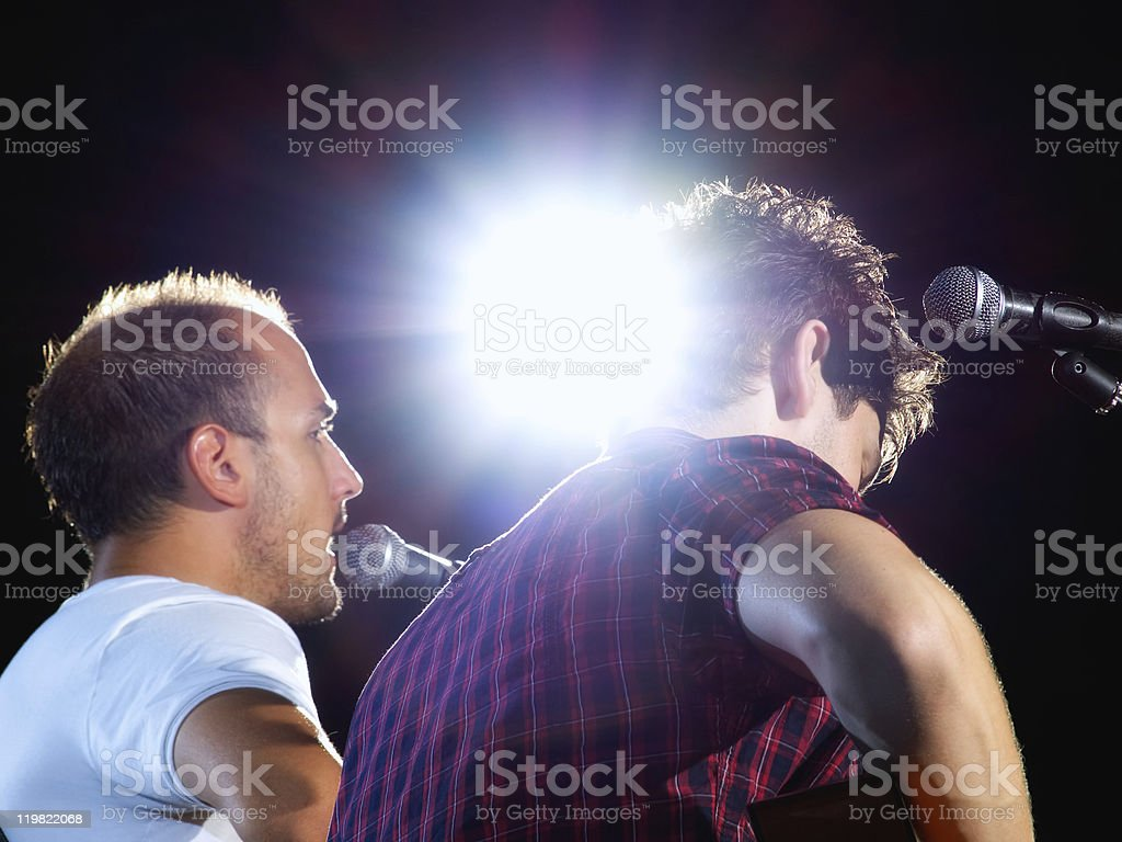 Back view of musicians with a halo light effect stock photo