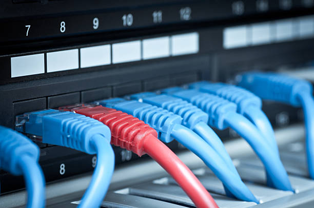 Back view of network hub and cables stock photo