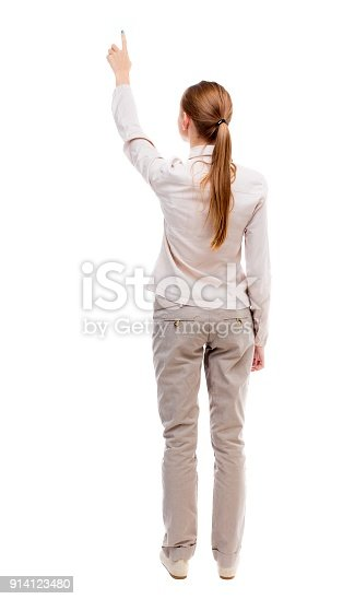 istock Back view of  pointing woman. 914123480