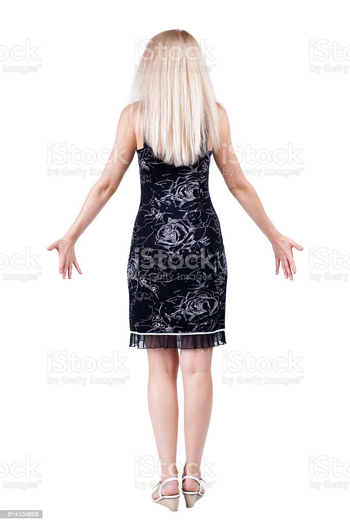 Back view of shocked woman in blue jeans. stock photo