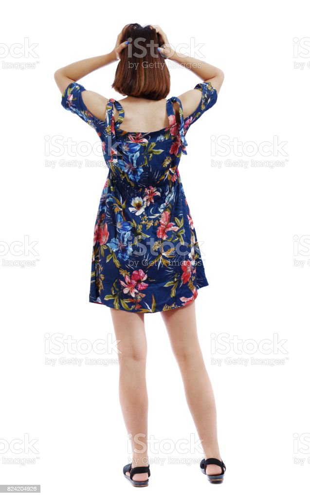 Back view of shocked woman in dress. stock photo