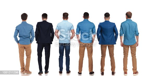 istock back view of six relaxed young men standing 1051211256