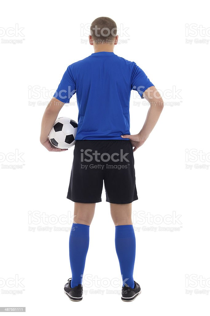 back view of soccer player in blue uniform stock photo