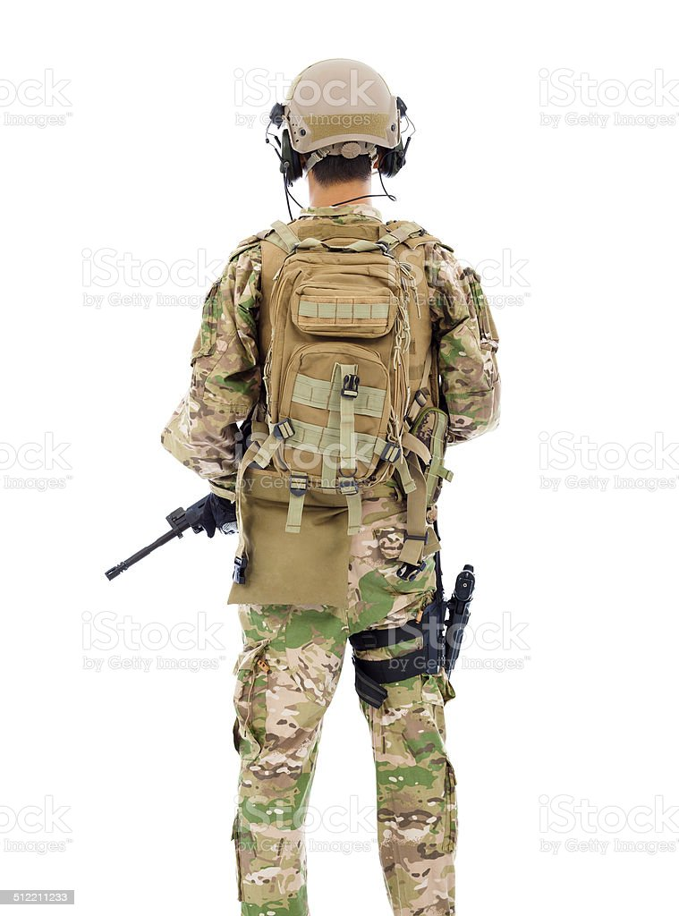 back view of soldier with rifle or sniper in studio stock photo