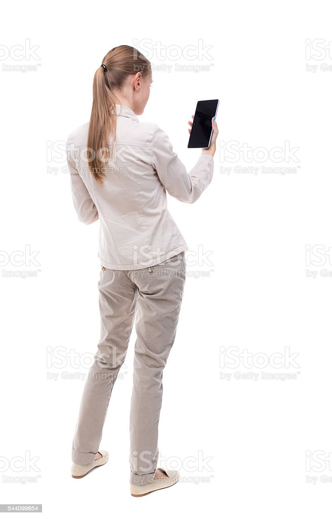 back view of standing young beautiful  girl with tablet computer stock photo