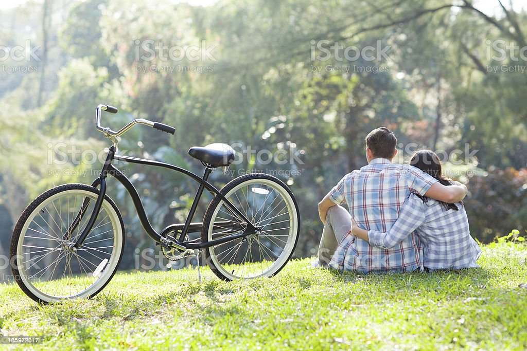 back view of teenage couple sitting outdoors royalty-free stock photo