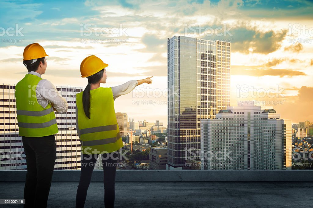 Back view of two architect looking the city stock photo
