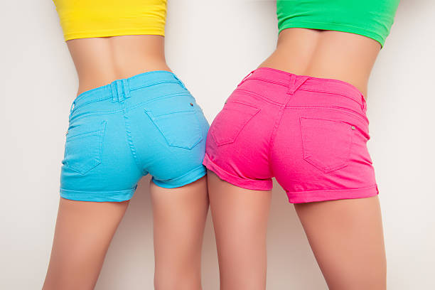 back view of two sexy girls showing their butt - buttock stock photos and pictures