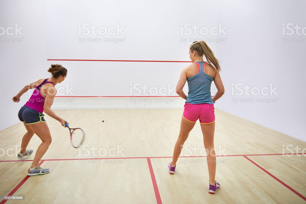 Back view of two squash players stock photo