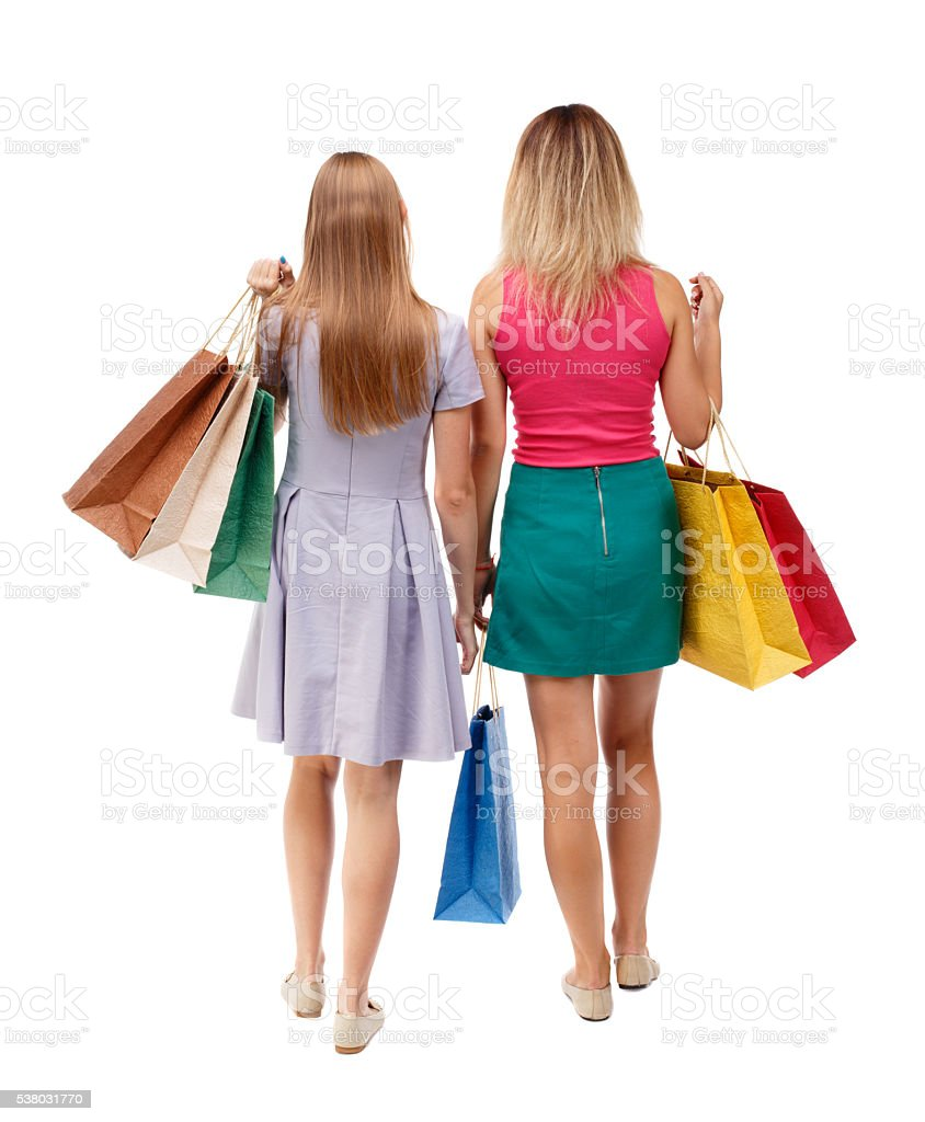 back view of two walking women with shopping bags カジュアルウェア