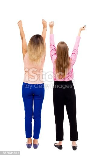 istock Back view of two young  women dancing. 587934514