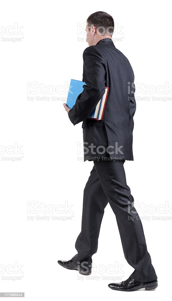 back view of walking  business man with books. royalty-free stock photo