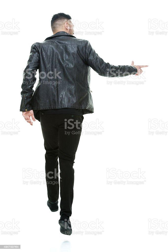 Back view of walking man stock photo