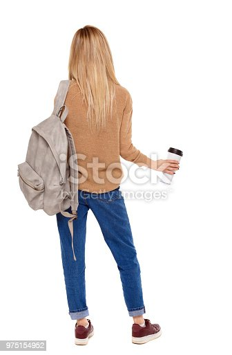 istock Back view of walking  woman  with coffee cup and backpack. 975154952