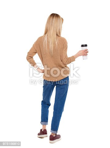 istock Back view of walking  woman  with coffee cup and backpack. 975156810