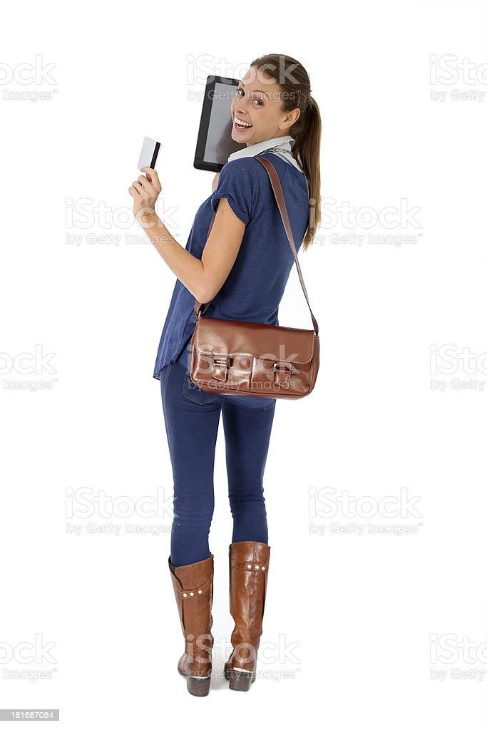 Back view of woman holding tablet and credit card royalty-free stock photo