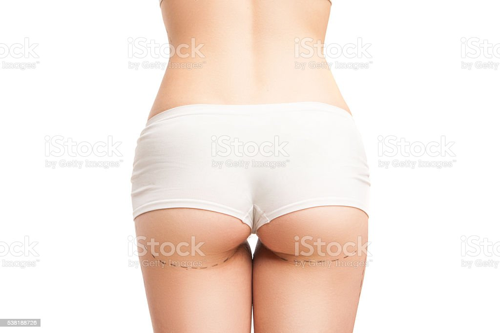 Back view of woman in panties with outlines on buttocks stock photo
