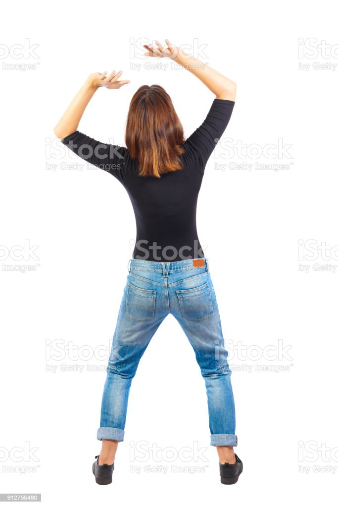 back view of woman  protects hands from what is falling from abo stock photo