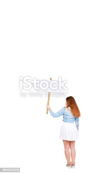 istock Back view  of woman showing a sign board. 594920026