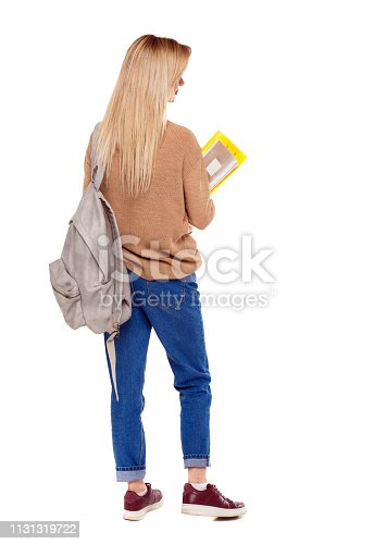 istock Back view of woman  with notebooks and backpack. 1131319722