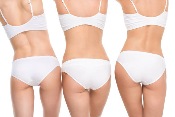 back view of women in underwear posing isolated on white back view of women in underwear posing isolated on white panties stock pictures, royalty-free photos & images