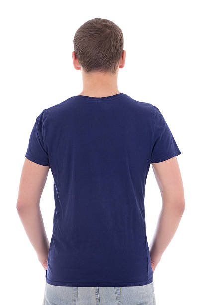 back view of young man in blue t-shirt stock photo