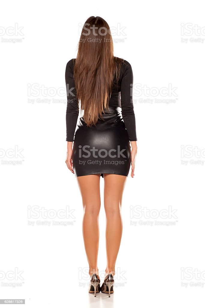 back view of young model in short leatjer skirt stock photo