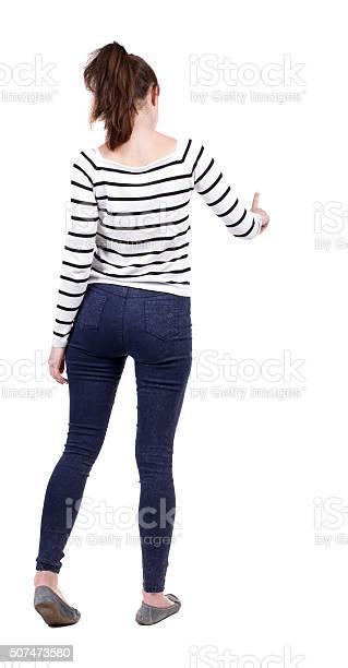 Back view of young woman presses down on something picture id507473580?b=1&k=6&m=507473580&s=612x612&h=k84o8exdbkupinqjttcieq3ww7v618re8ku9ve0nvw4=