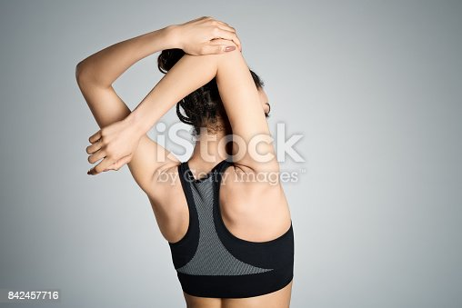 istock Back view of young woman stretching her arms 842457716