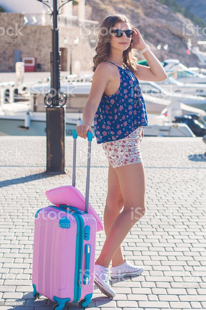 Back view traveler girl with pink suitcase royalty-free stock photo