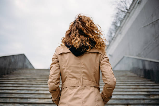 Back view young woman with curly hair stock photo