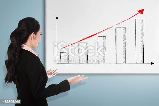 istock Back view young woman with white board 483808266