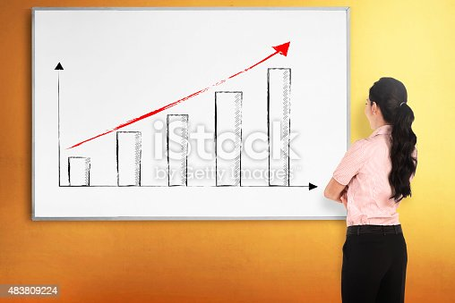 istock Back view young woman with white board 483809224