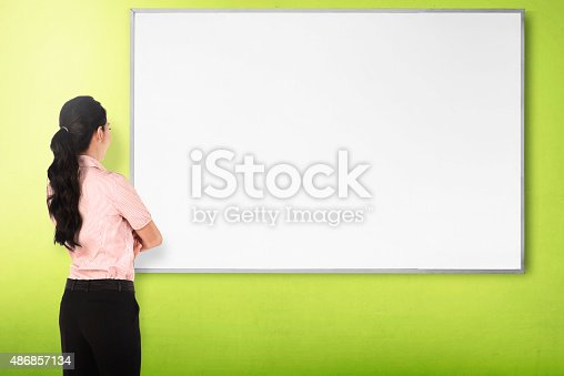 istock Back view young woman with white board 486857134