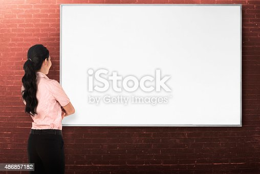 istock Back view young woman with white board 486857182