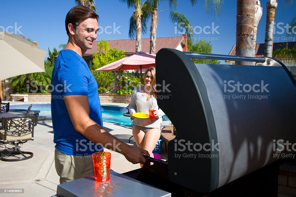 Back Yard BBQ Man and Girlfriend stock photo