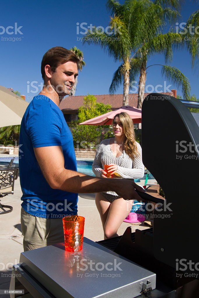 Back Yard BBQ Man and Girlfriend Vertical stock photo