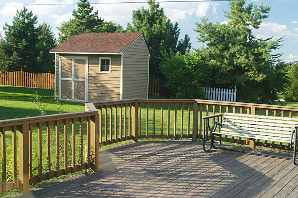 Back Yard Deck Swing & Barn stock photo