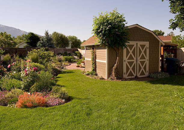Back Yard Scene Manicured backyard with flowers, shed stock pictures, royalty-free photos & images